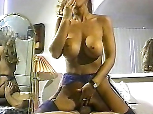 Huge boobs clasic porn star riding a cock
